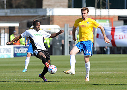 Dover Athletic's Solomon Taiwo is challenged by Bristol Rovers' Chris Lines  - Photo mandatory by-line: Neil Brookman/JMP - Mobile: 07966 386802 - 18/04/2015 - SPORT - Football - Dover - Crabble Athletic Ground - Dover Athletic v Bristol Rovers - Vanarama Football Conference