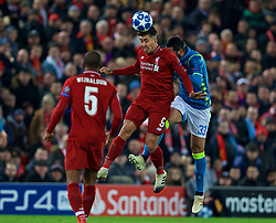 LIVERPOOL, ENGLAND - Tuesday, December 11, 2018: Liverpool's Roberto Firmino (L) and Napoli's Raúl Albiol during the UEFA Champions League Group C match between Liverpool FC and SSC Napoli at Anfield. (Pic by David Rawcliffe/Propaganda)
