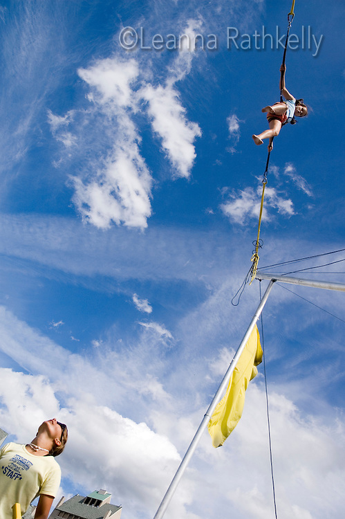 Girl, 10-12, enjoys the bungee jump at the Adventure Zone, Blackcomb Mountain, Whistler, BC Canada.