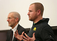 Logan Edwards of Davenport answers a question during the discussion section of a forum about medical cannabis at the Iowa City Public Library in Iowa City on Tuesday, November 19, 2013.