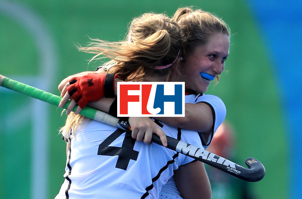 RIO DE JANEIRO, BRAZIL - AUGUST 15:  Cecile Pieper #22 and Nike Lorenz #4 of Germany celebrate following a victory over the United States in a quarterfinal match at the Olympic Hockey Centre on August 15, 2016 in Rio de Janeiro, Brazil.  (Photo by Sam Greenwood/Getty Images)