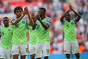 Nigeria forward Alex Iwobi (18) and teammates applaud the visiting fans after the Friendly International match between England and Nigeria at Wembley Stadium, London, England on 2 June 2018. Picture by Toyin Oshodi.