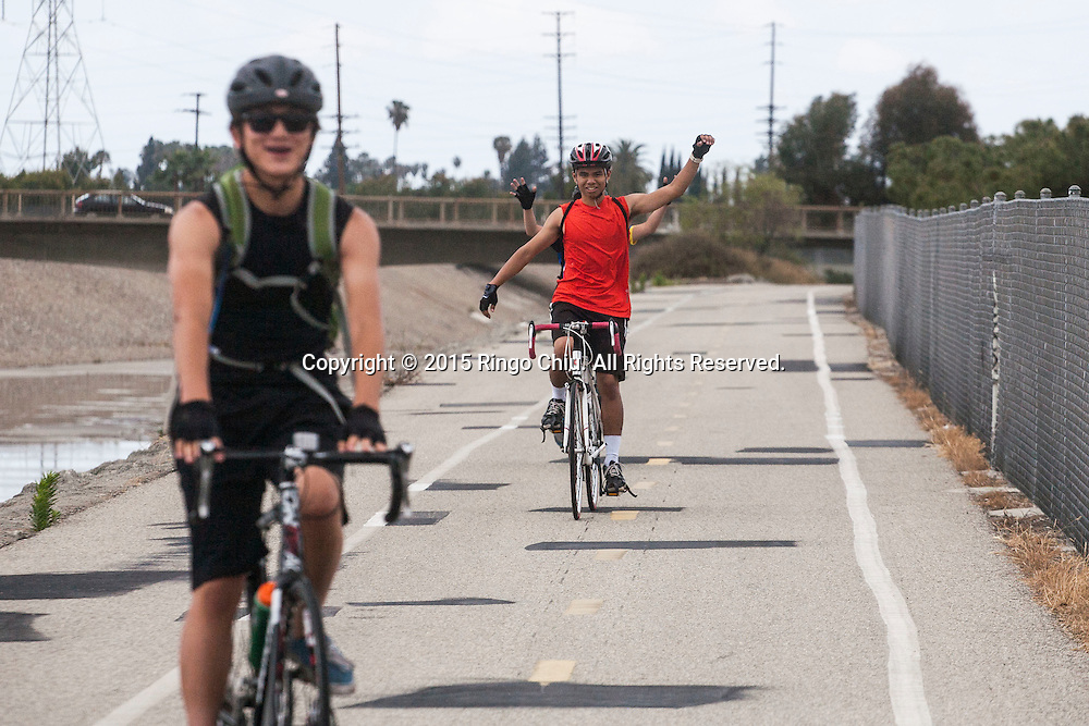 Kyle Chiu completes the Cycling, one of three fitness merit badges, during the First Annual San Gabriel Valley Council Boy Scouts of America 50 Mile Bike Ride on Saturday May 16, 2015. The event starts at Whittier Narrows Park in El Monte, ride along Rio Hondo and Los Angeles River bike Paths to the ocean at Long Beach and back. (Photo by Ringo Chiu/PHOTOFORMULA.com)