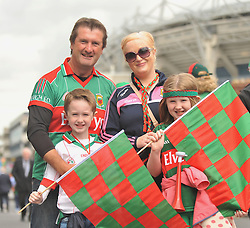 Mayo fans Sean and Triona Coyle with their kids John and Kayla on their way to the All Ireland Semi-final between Mayo and Dublin on sunday last.<br /> Pic Conor McKeown