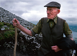 IRELAND CO. MAYO CORAGH PATRICK JUL99 - An elderly pilgrim ascends Croagh Patrick mountain in western Ireland. Around 25,000 people, some of which are bare-footed, participate in this pilgrimage to the top of Croagh Patick mountain on the last Sunday of July from where in 441 A.D. St. Patrick supposedly sent Ireland's reptiles to their doom. ..jre/Photo by Jiri Rezac..© Jiri Rezac 1999..Contact: +44 (0) 7050 110 417.Mobile: +44 (0) 7801 337 683.Office: +44 (0) 20 8968 9635..Email: jiri@jirirezac.com.Web: www.jirirezac.com..© All images Jiri Rezac 1999 - All rights reserved.