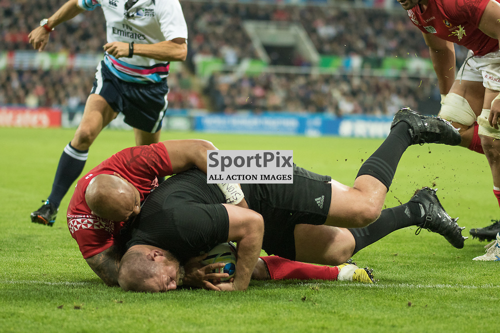 New Zealand #1 Tony Woodcock drives over for a New Zealand try.<br /> New Zealand v Tonga, 9th October 2015