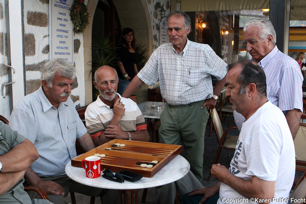 June 1, 2014 - A group of men play a game of backgammon, on a quiet  evening, on the Greek island of Patmos.