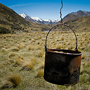 Antique bucket exposed to the weather outside an old sheep station hut high in the Arrowsmith Range, South Island, New Zealand. Photo by Jen Klewitz