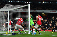Football - 2019 / 2020 Premier League - Arsenal vs. Brighton & Hove Albion<br /> <br /> Arsenal's Alexandre Lacazette (left post) scores his side's equalising goal to make the score 1-1, at The Emirates.<br /> <br /> COLORSPORT/ASHLEY WESTERN