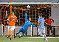 July 18, 2018 - Houston, TX, U.S. - HOUSTON, TX - JULY 18:  Houston Dynamo goalkeeper Chris Seitz (18) reaches to tip the ball away from the goal area during the US Open Cup Quarterfinal soccer match between Sporting KC and Houston Dynamo on July 18, 2018 at BBVA Compass Stadium in Houston, Texas. (Photo by Leslie Plaza Johnson/Icon Sportswire) (Credit Image: © Leslie Plaza Johnson/Icon SMI via ZUMA Press)