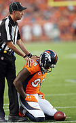 An official steadies Denver Broncos wide receiver Demaryius Thomas (88) after a hard hit during a first quarter pass reception for a first down at the Carolina Panthers 16 yard line during the 2016 NFL week 1 regular season football game against the Carolina Panthers on Thursday, Sept. 8, 2016 in Denver. The Broncos won the game 21-20. (©Paul Anthony Spinelli)