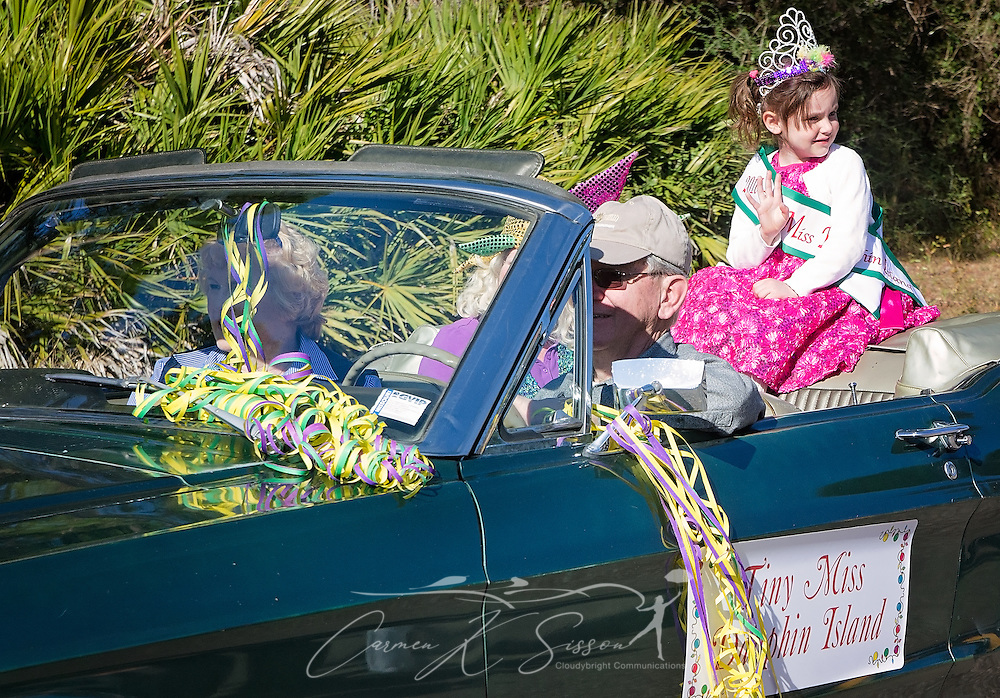 Ari Ladnier, 2016 Tiny Miss Dauphin Island, waves to the crowd as she rides in Dauphin Island's first People's Parade during Mardi Gras, Feb. 4, 2017, in Dauphin Island, Alabama. French settlers held the first Mardi Gras in 1703, making Mobile's celebration the oldest Mardi Gras in the United States. The first parade of the season is traditionally held on Dauphin Island and draws thousands. (Photo by Carmen K. Sisson/Cloudybright)