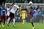 (R) Trabzonspor's Jose Bosingwa fights for the ball with (L) Legia's Jakub Kosecki during the UEFA Europa League Group J football match between Legia Warsaw and Trabzonspor AS at Pepsi Arena Stadium in Warsaw on November 07, 2013.<br /> <br /> Poland, Warsaw, November 07, 2013<br /> <br /> Picture also available in RAW (NEF) or TIFF format on special request.<br /> <br /> For editorial use only. Any commercial or promotional use requires permission.<br /> <br /> Mandatory credit:<br /> Photo by &copy; Adam Nurkiewicz / Mediasport
