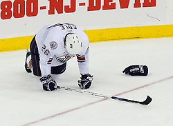Nov 9, 2008; Newark, NJ, USA; Edmonton Oilers right wing Erik Cole (26) lies on the ice after getting injured during the third period of their game against the New Jersey Devils at the Prudential Center. The Oilers defeated the Devils 2-1.