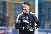 AFC Wimbledon goalkeeper Joe McDonnell (24) warming up during the EFL Sky Bet League 1 match between AFC Wimbledon and Charlton Athletic at the Cherry Red Records Stadium, Kingston, England on 10 April 2018. Picture by Matthew Redman.