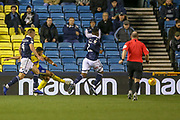 Goal!…Birmingham City forward Che Adams (9) shoots and  Millwall concede an own goal during the EFL Sky Bet Championship match between Millwall and Birmingham City at The Den, London, England on 28 November 2018.