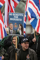 © Licensed to London News Pictures. 19/03/2016. London, UK. Members of right-wing group Britain First stage a small counter demonstration. Thousands march through central London on UN anti-racism day to demand that the British government accept a greater share of refugees seeking asylum in Europe. Photo credit : Rob Pinney/LNP