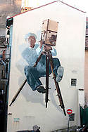France, Cannes, Gigate mural of a film director in the old town close to Palace de Cinema, Cannes