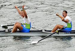 Goldmedalists Jure Grace (R) and Domanjko Grega of Slovenia celebrate winning junior men's pair of rowing at the Singapore 2010 Youth Olympic Games at the Marina Bay in Singapore, August 18, 2010. .XINHUA/SYOGOC-Pool/Song Zhenping. Only for Slovenia.