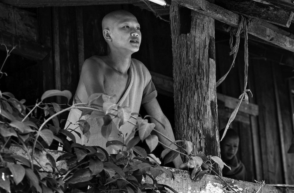 A novice monk at his Wat near Luang Prabang, Laos.