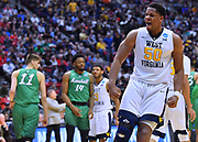 SAN DIEGO, CA - MARCH 18:  West Virginia Mountaineers forward Sagaba Konate (50) celebrates after a dunk against the Marshall Thundering Herd during a second round game of the Men's NCAA Basketball Tournament at Viejas Arena in San Diego, California.  (Photo by Sam Wasson)