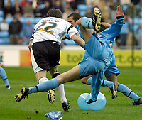 Photo: Ed Godden.<br />Coventry City v Derby County. Coca Cola Championship. 11/11/2006. Matt Oakley (L) brings Coventry's Richard Duffy to the ground.