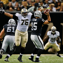 Aug 16, 2013; New Orleans, LA, USA; New Orleans Saints defensive tackle Akiem Hicks (76) pressures Oakland Raiders quarterback Matt Flynn (15) during the second quarter of a preseason game at the Mercedes-Benz Superdome. Mandatory Credit: Derick E. Hingle-USA TODAY Sports