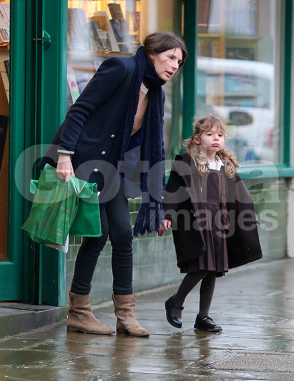 Jools Oliver visits a bookshop with her youngest daughter Petal Blossom Rainbow before picking up some Fruit &amp; Veg in London, UK. 15/01/2014<br />BYLINE MUST READ : GOTCHAIMAGES.COM<br /><br />Copyright by &copy; Gotcha Images Ltd. All rights reserved.<br />Usage of this image is conditional upon the acceptance <br />of Gotcha Images Ltd, terms and conditions available at<br />www.gotchaimages.com<br /><br />UK clients should be aware children's faces may need pixelating.