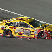 NASCAR Sprint Cup driver Joey Logano (22) leaves the racetrack after a crash during the NASCAR Coke Zero 400 Sprint series auto race at the Daytona International Speedway on Saturday, July 6, 2013 in Daytona Beach, Florida.  (AP Photo/Alex Menendez)