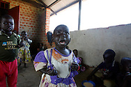 October 6, 2006 - A girl cries after loosing her bowl of porridge to a classmate at a day care center in Coope camp for internally displaced people, or IDP, near Gulu in north Uganda. Coope, with a population of 18,000, is one of 76 IDP camps around Gulu, the main base for the Uganda Peoples Defense Force fighting the insurgent Joseph Kony's Lord's Resistance Army. Kony's LRA movement has been fighting for the past 20 years to force the East African country to be ruled according to the Christian Ten Commandments. Over 2 million people, mostly of the Acholi tribe, have moved or were forced to move from their villages to camps close to the towns of Gulu, Lira, and Kitgum where they are watched over by the Ugandan Army. The LRA rebels have abducted thousands of children and have forced them to fight against the Ugandan Army and the Acholi people. Current peace talks between Kony's LRA and the Ugandan government held in Juba, southern Sudan, offer a glimpse of hope to ending this ongoing conflict..(Photo by Jakub Mosur/Polaris)<br />