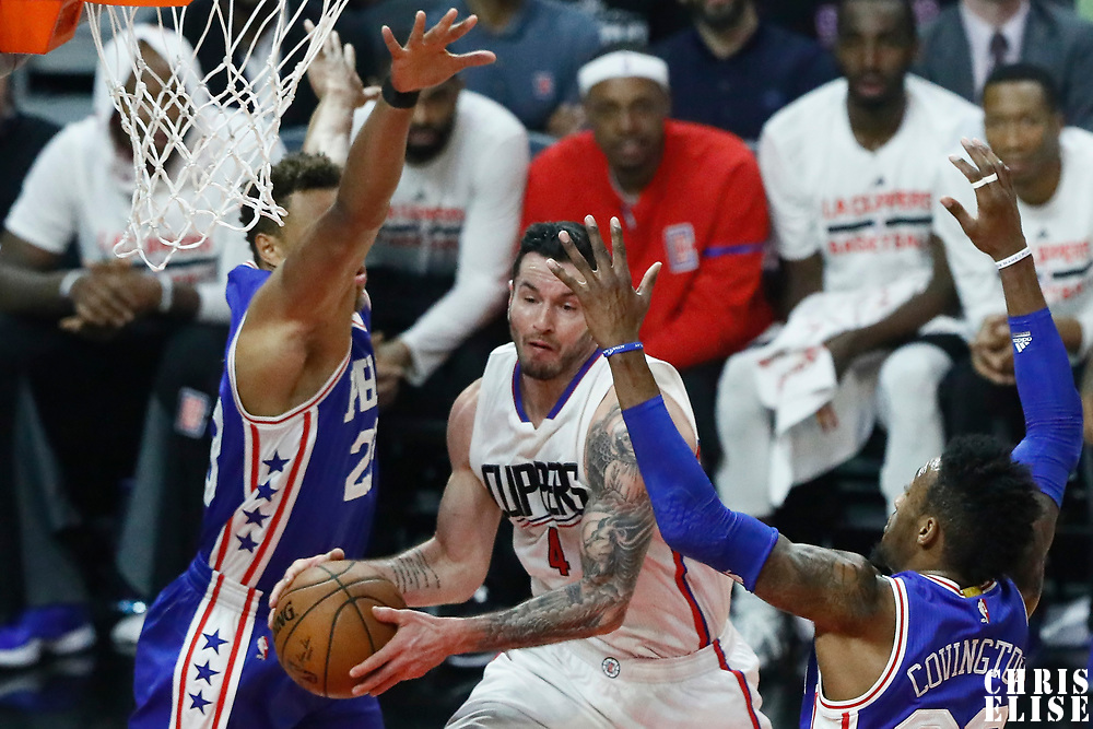 11 March 2017: LA Clippers guard J.J. Redick (4) goes for the layup past Philadelphia 76ers forward Richaun Holmes (22) and Philadelphia 76ers forward Robert Covington (33) during the LA Clippers 112-100 victory over the Philadelphia Sixers, at the Staples Center, Los Angeles, California, USA.