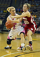 February 16 2011: Iowa Hawkeyes guard Kamille Wahlin (2) tries to pass around Wisconsin Badgers guard Alyssa Karel (30) during the first half of an NCAA women's college basketball game at Carver-Hawkeye Arena in Iowa City, Iowa on February 16, 2011. Iowa defeated Wisconsin 59-44.