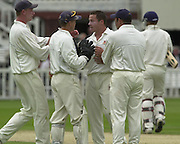 .Sport - Cricket - 22/06/02.Photo Peter Spurrier.Benson & Hedges - Final Lords Essex vs Warwickshire.Wicket keeper Andy Flower and Graham Napier, congratulate each other, on the taking of Jim Troughton's wicket [Mandatory Credit: Peter Spurrier:Intersport Images]