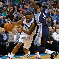 January 19, 2011; New Orleans, LA, USA; New Orleans Hornets guard Marcus Thornton (5) drives past Memphis Grizzlies shooting guard O.J. Mayo (32) during the fourth quarter at the New Orleans Arena. The Hornets defeated the Grizzlies 130-102 in overtime.  Mandatory Credit: Derick E. Hingle