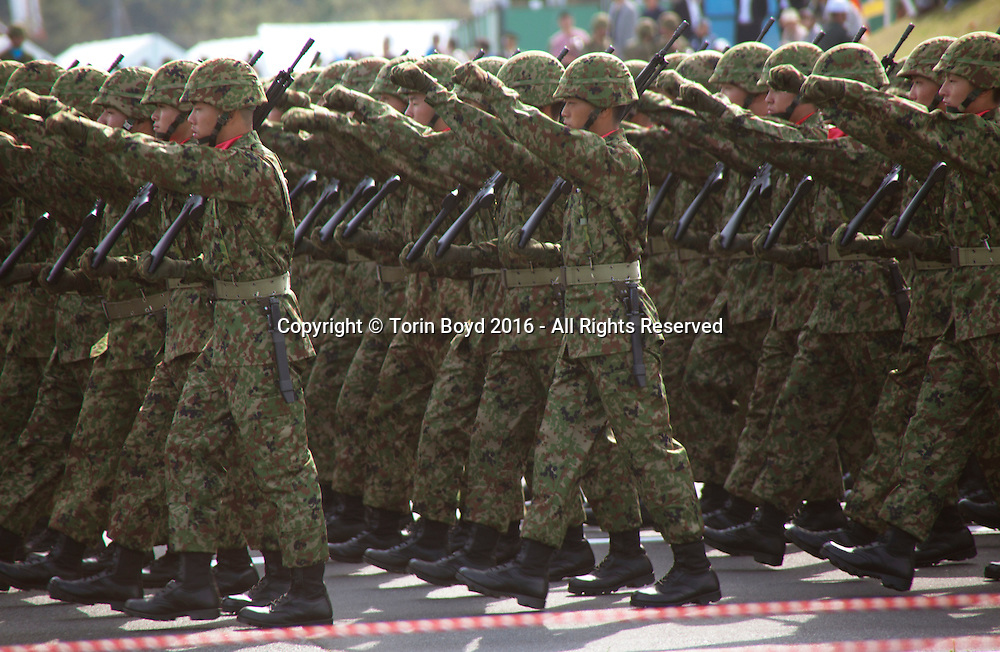October, 23, 2016, Asaka, Saitama Prefecture, Japan: Infantry units of the Japan Ground Self Defense Force in full regalia during the annual military review held at the Asaka Training Area, a Japan Ground Self Defense Force (JSDF) base on the outskirts of Tokyo. For this event, Prime Minister Shinzo Abe, top ranking Japanese brass and international dignitaries were in attendance to view Japan's military might. This included 4000 troops, 27 divisions, 280 vehicles and artillery, plus 50 aircraft of the Ground, Air, and Maritime branches of the JSDF. (Torin Boyd/Polaris).
