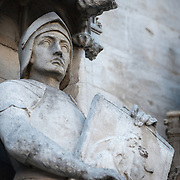 Statue of a knight on the exterior of the Brussels Town Hall (Hotel de Ville) on Grand Place (La Grand-Place), a UNESCO World Heritage Site in central Brussels, Belgium. Lined with ornate, historic buildings, the cobblestone square is the primary tourist attraction in Brussels.