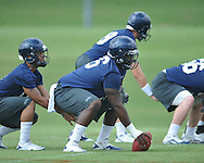 Center A.J. Hawkins goes through a drill as the University of Mississippi began football practice in Oxford, Miss. on Saturday, August 6, 2011. The team began practicing outside before lightning in the area sent them indoors for practice. (AP Photo/Oxford Eagle, Bruce Newman)