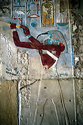 Ancient Egyptian Ibis-headed god Thoth, secretary to the gods and patron of scribes. wall painting from temple of Rameses II (1198-1167 BC) at Medinet Habu .