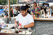 Queens, NY - October 2, 2016. Preparing and serving arepas at The Arepa Lady at The Feastival of Queens at The Meadows Festival at Citi Field.