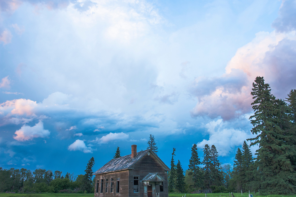 Old one room school house under a prairie Manitoba sky.