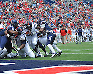 Jeremy Liggins (15) scores at Mississippi's Grove Bowl controlled scrimmage at Vaught-Hemingway Stadium in Oxford, Miss. on Saturday, April 5, 2014.