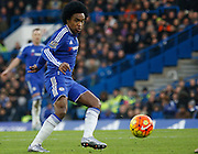 Chelsea attacker Willian plays a pass out wide during the Barclays Premier League match between Chelsea and Everton at Stamford Bridge, London, England on 16 January 2016. Photo by Andy Walter.