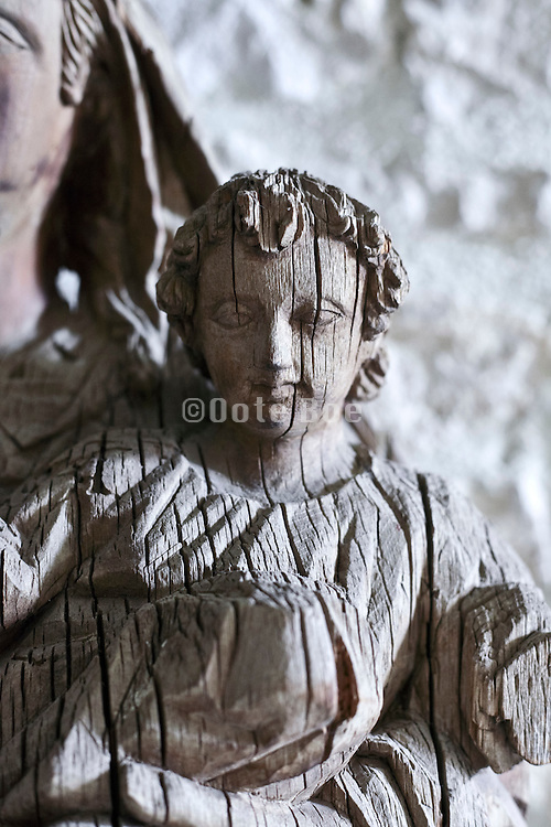old dried out splitting wood portrait sculpture of the religious figure baby Jesus
