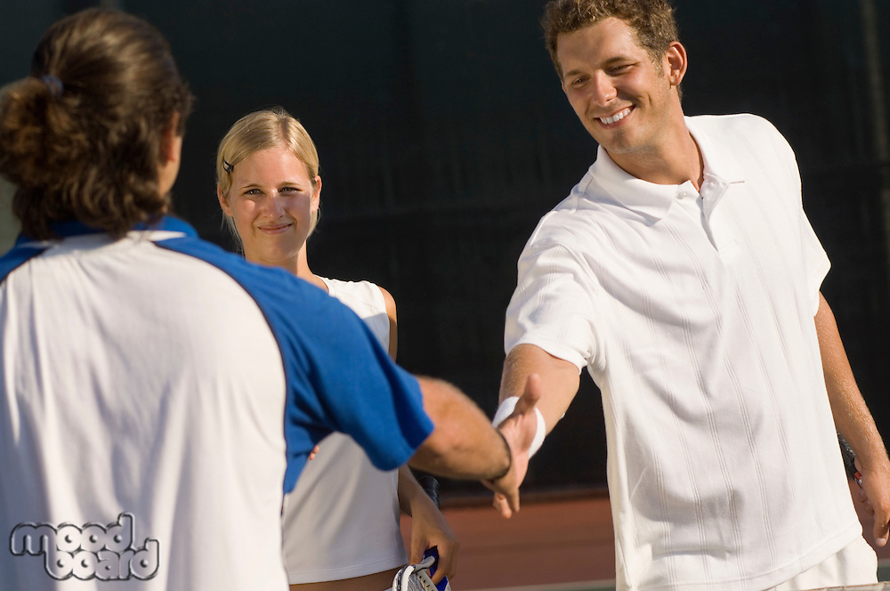 Tennis Players Shaking Hands at Net