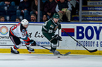 KELOWNA, BC - FEBRUARY 28: Ethan Ernst #19 of the Kelowna Rockets stick checks Wyatte Wylie #29 of the Everett Silvertips during second period at Prospera Place on February 28, 2020 in Kelowna, Canada. (Photo by Marissa Baecker/Shoot the Breeze)