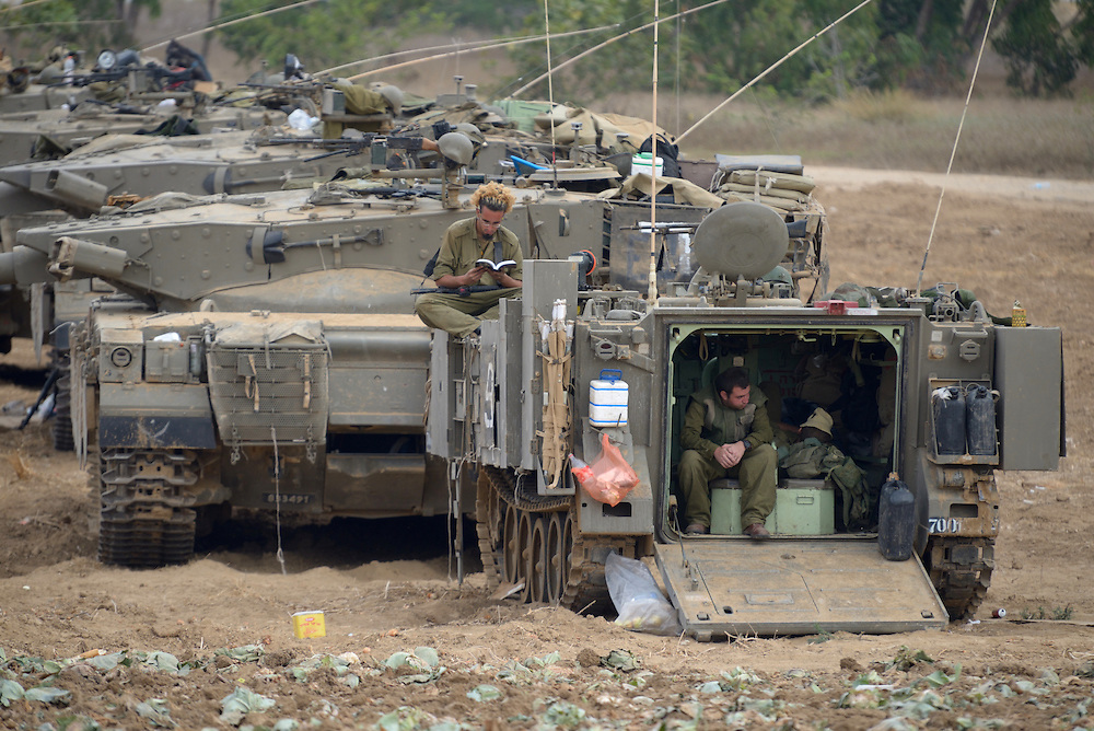 IDF tanks and soldiers in Southern Israel near the border with Gaza, on the 4'th day of Operation Protective Edge, July 11, 2014. As Israel prepares for a wider operation, Gaza militants continue firing into Southern and central Israel. Photo by Gili Yaari