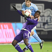 Andoni Iraola, NYCFC, and Carlos Rivas, (front), Orlando, challenge for the ball during the New York City FC Vs Orlando City, MSL regular season football match at Yankee Stadium, The Bronx, New York,  USA. 18th March 2016. Photo Tim Clayton