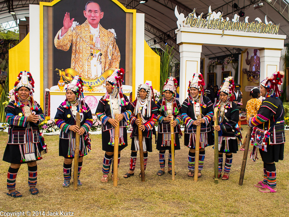 02 DECEMBER 2014 - BANGKOK, THAILAND: Akha hilltribe people gather on Sanam Luang in Bangkok before the Trooping of the Colors, during a celebration of the King's Birthday. The Thai Royal Guards parade, also known as Trooping of the Colors, occurs every December 2 in celebration of the birthday of Bhumibol Adulyadej, the King of Thailand. The Royal Guards of the Royal Thai Armed Forces perform a military parade and pledge loyalty to the monarch. Historically, the venue has been the Royal Plaza in front of the Dusit Palace and the Ananta Samakhom Throne Hall. This year it was held on Sanam Luang in front of the Grand Palace.    PHOTO BY JACK KURTZ