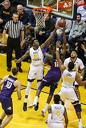 Feb 12, 2018; Morgantown, WV, USA; West Virginia Mountaineers forward Wesley Harris (21) blocks a shot from TCU Horned Frogs forward Kouat Noi (12) during the first half at WVU Coliseum. Mandatory Credit: Ben Queen-USA TODAY Sports