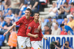 WIGAN, ENGLAND - Sunday, May 11, 2008: Manchester United's Cristiano Ronaldo celebrates after scoring another easily awarded penalty, with Michael Carrick, during the final Premiership match of the season against Wigan Athletic at the JJB Stadium. (Photo by David Rawcliffe/Propaganda)